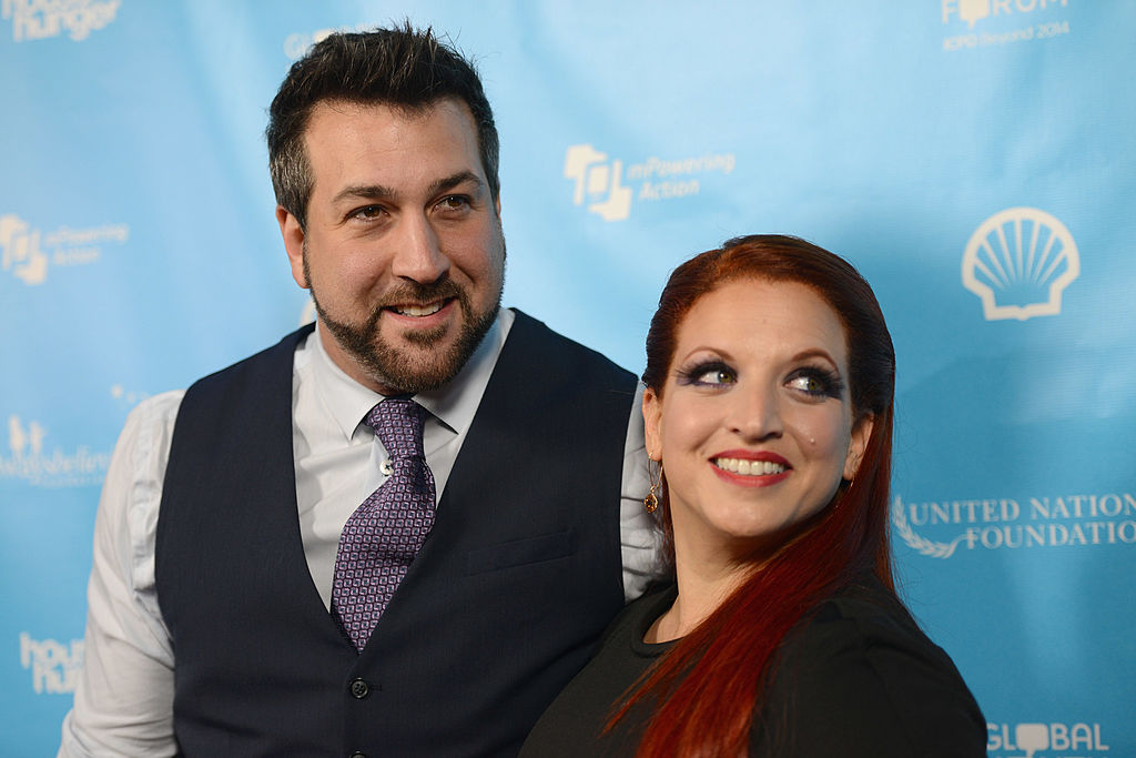 joey fatone and his wife posing for a red carpet photo