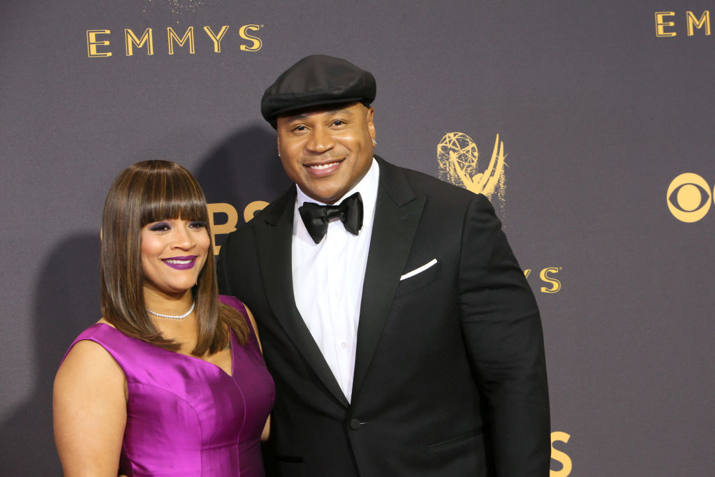 ll cool j wearing a tuxedo and a hat and his wife simone smith wearing a purple dress on a red carpet