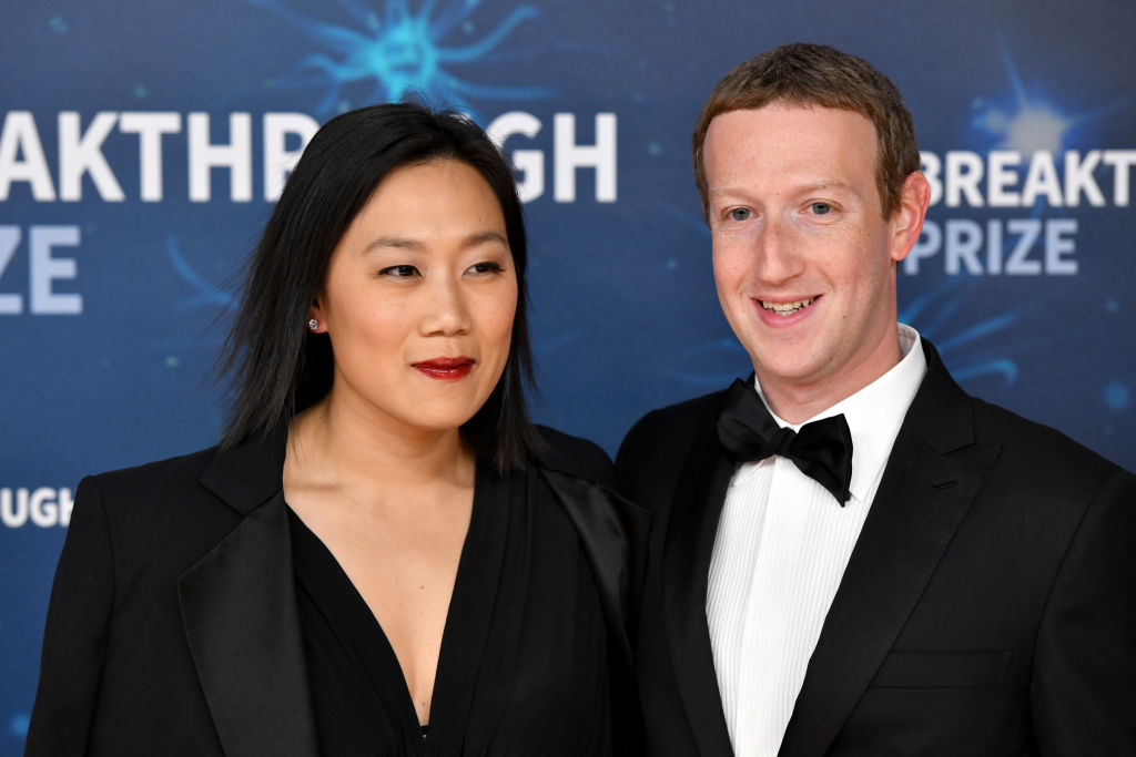 mark zuckerberg dressed in a tuxedo with wife priscilla chin at a red carpet event