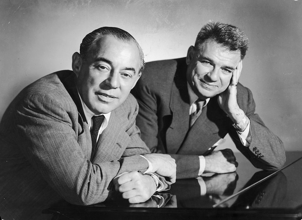 richard rodgers and oscar hammerstein black and white photo of them leaning over a piano