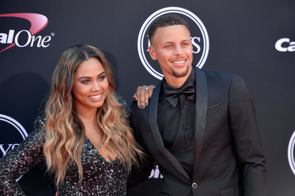 steph curry wearing a tuxedo and ayesha curry wearing a sequin dress on a red carpet