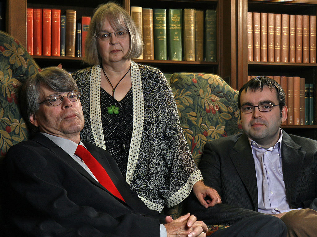 stephen king with his wife and son sitting in a library