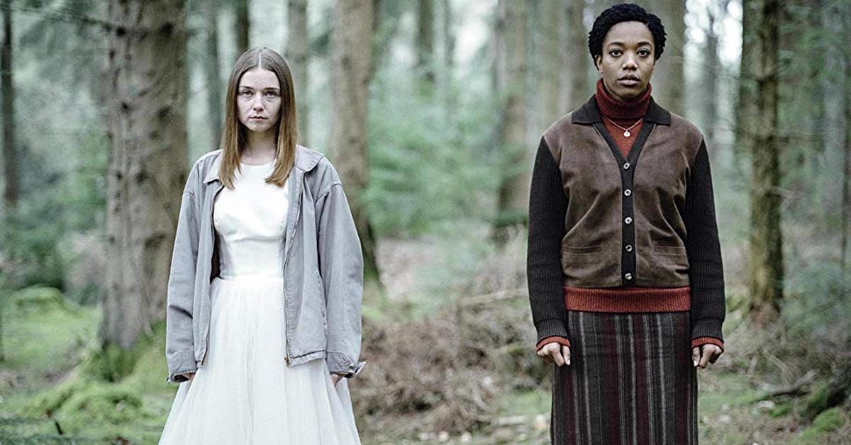 jessica barden and naomi ackie standing in a forest