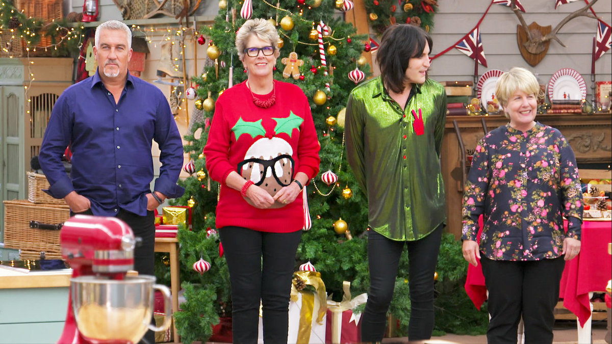 judges in christmas garb on the great british baking show