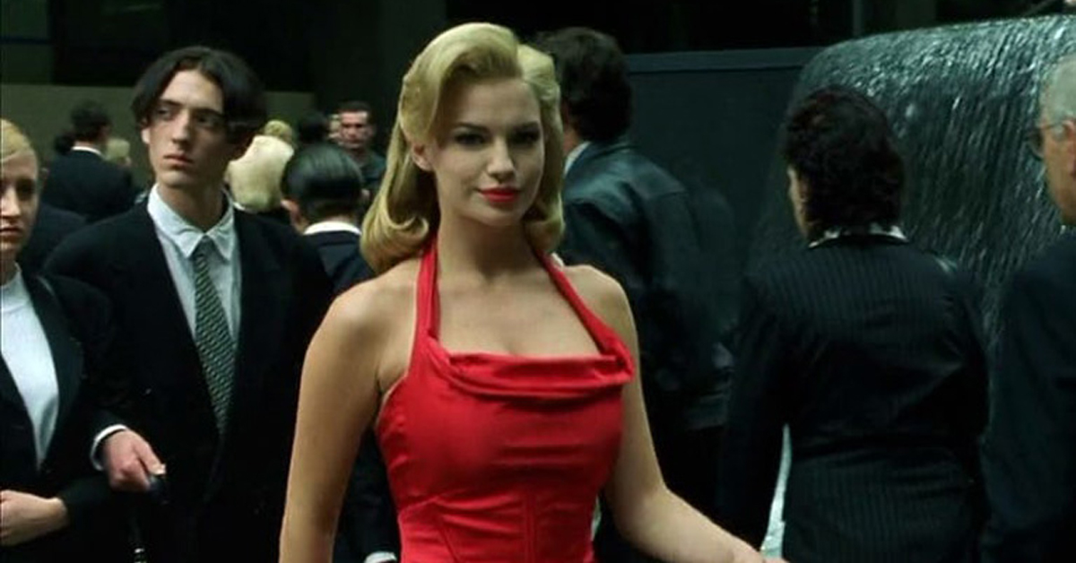 a woman in a red dress in the matrix