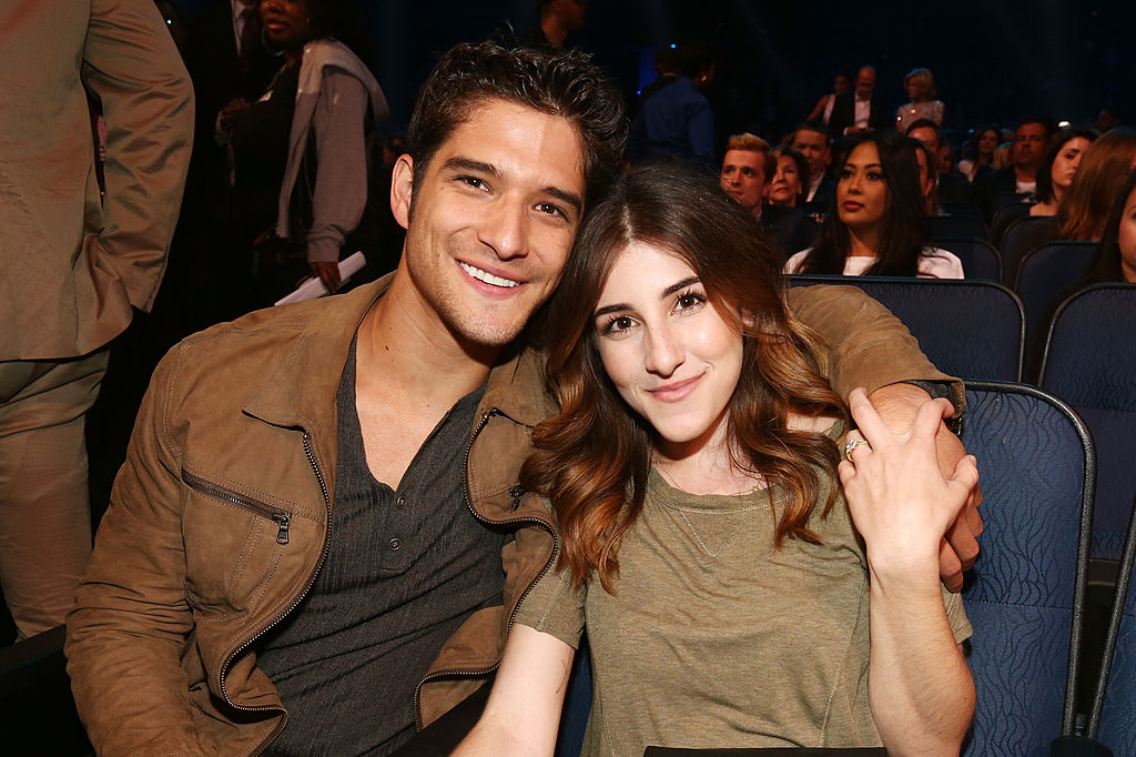 tyler posey and wife seana gorlick in theater seats