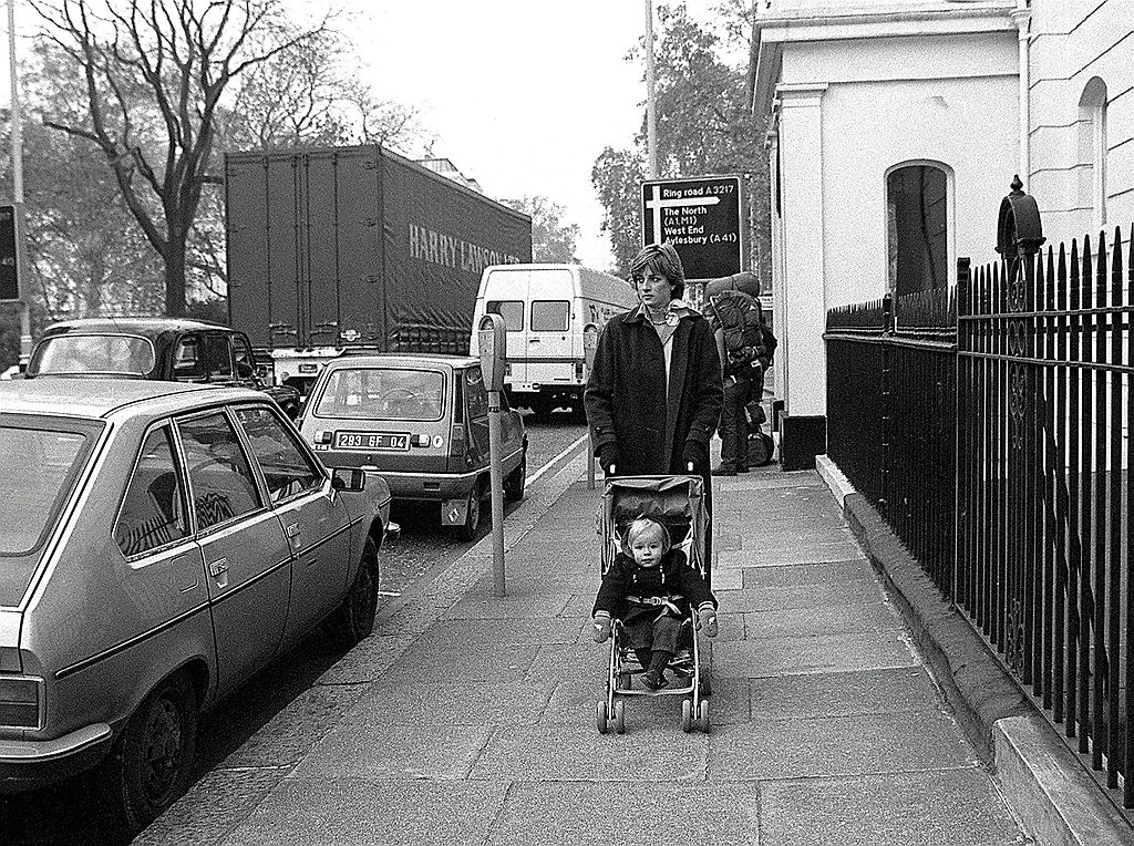Lady Diana Spencer takes her young charge Patrick Robinson for his daily outing in the Eaton Square district of London