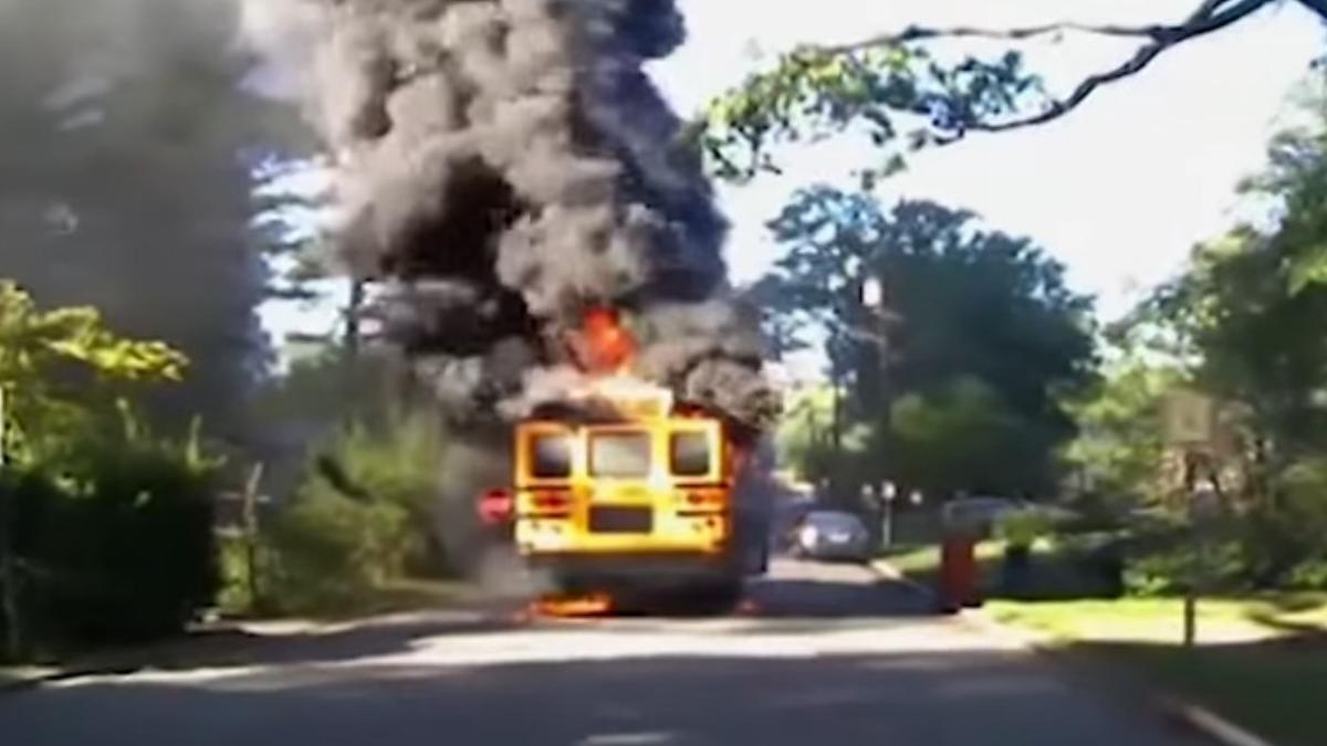 bus on fire in residential neighborhood