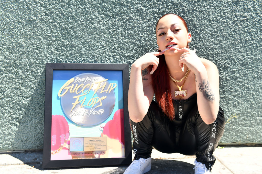 Danielle Bregoli squats down and bares her teeth.