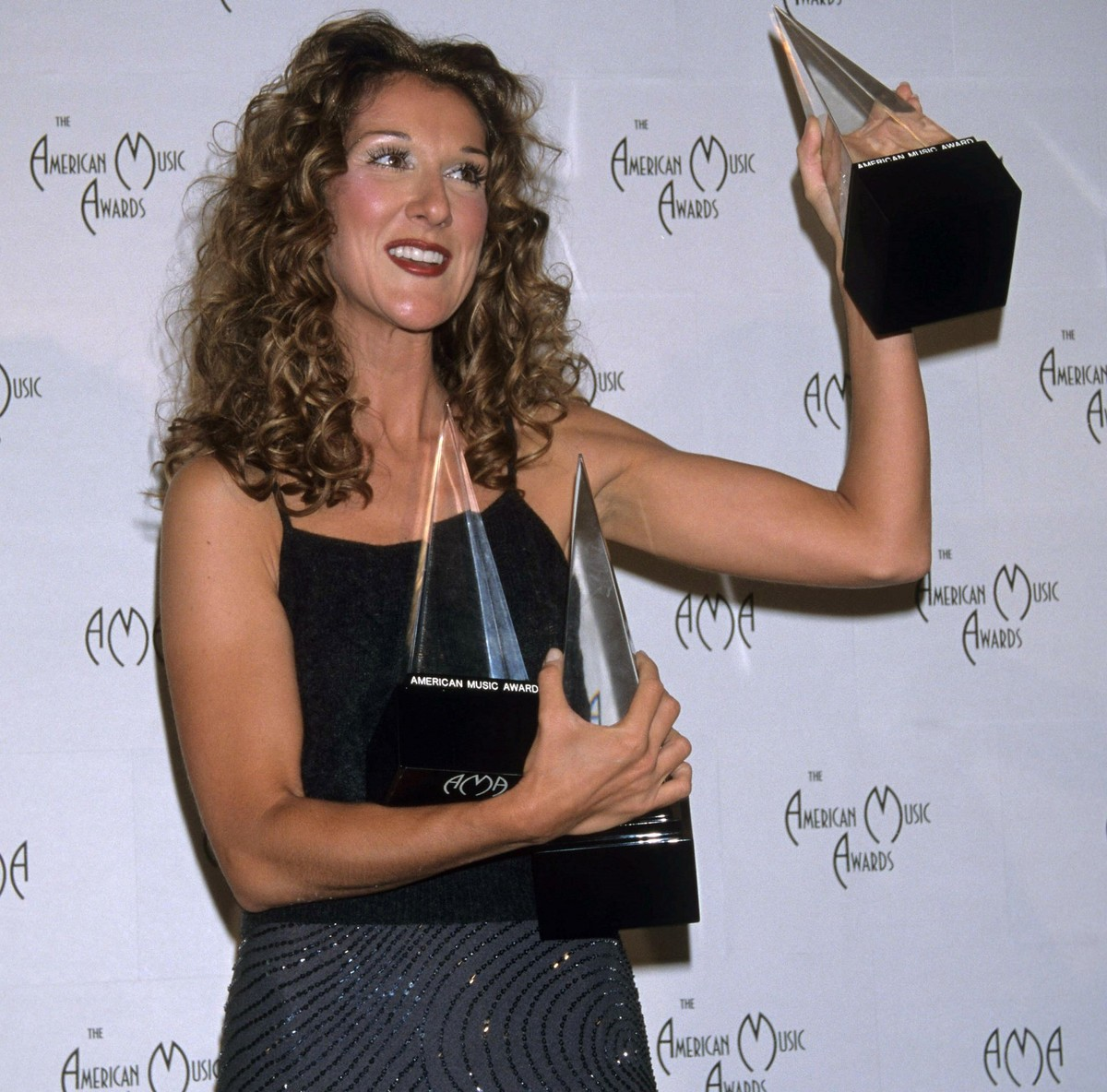 Celine Dion holds three AMAs.