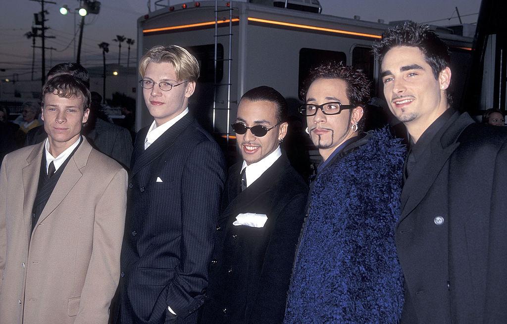 The Backstreet Boys pose together.