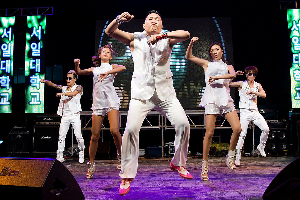 PSY and his backup dancers perform