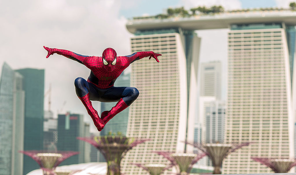 A photo capture Spiderman leaping up in the air.
