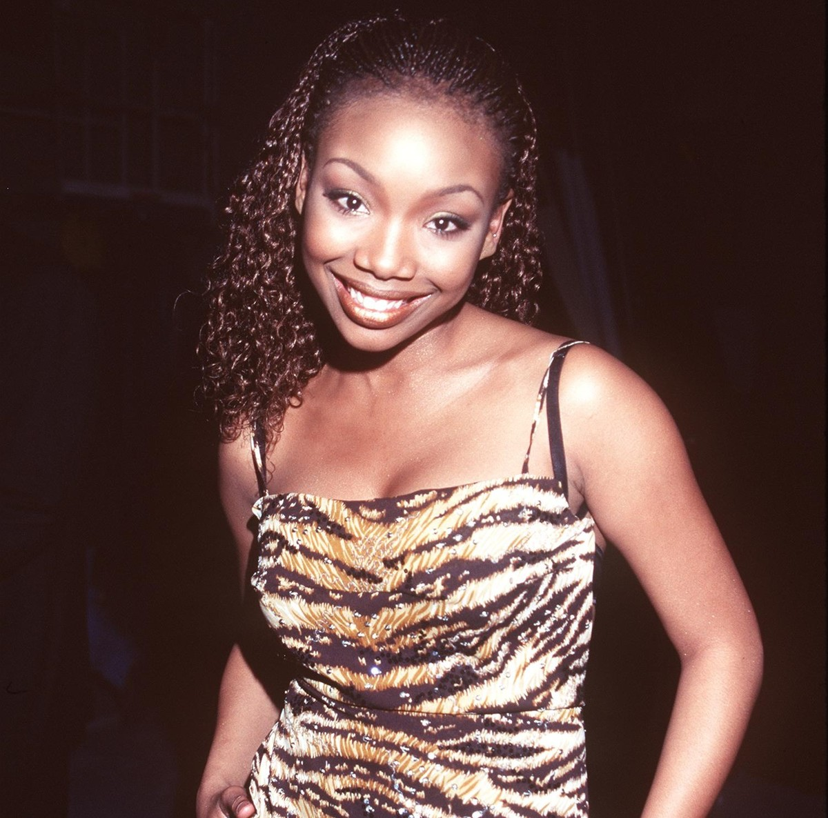 The singer Brandy smiles for a photo.
