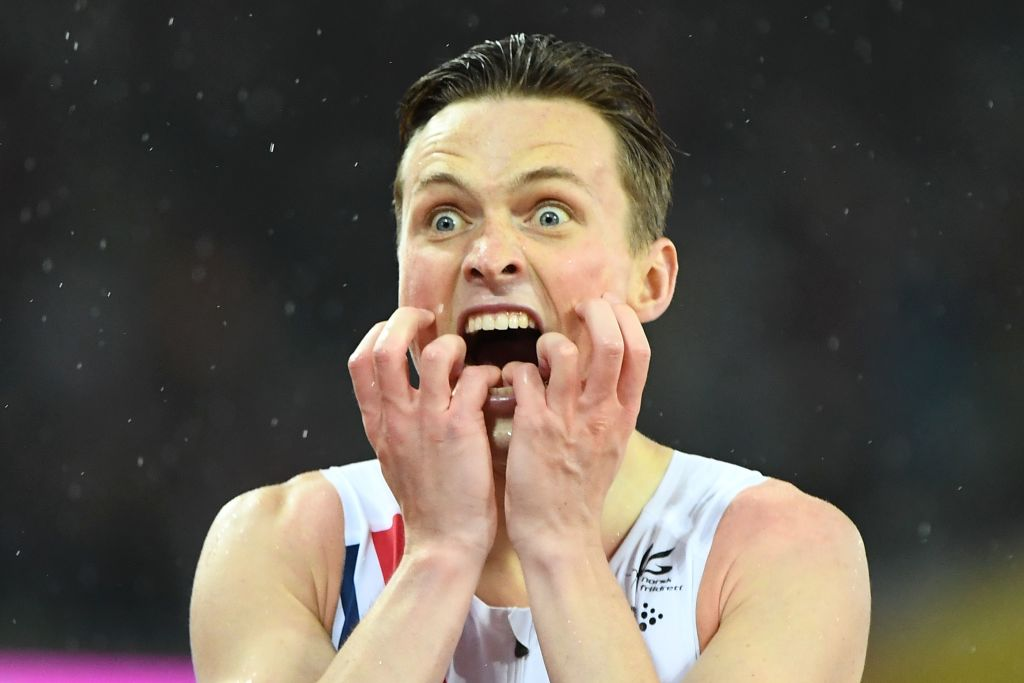 An athlete had wide eyes and an open mouth while hearing the results at a competition.