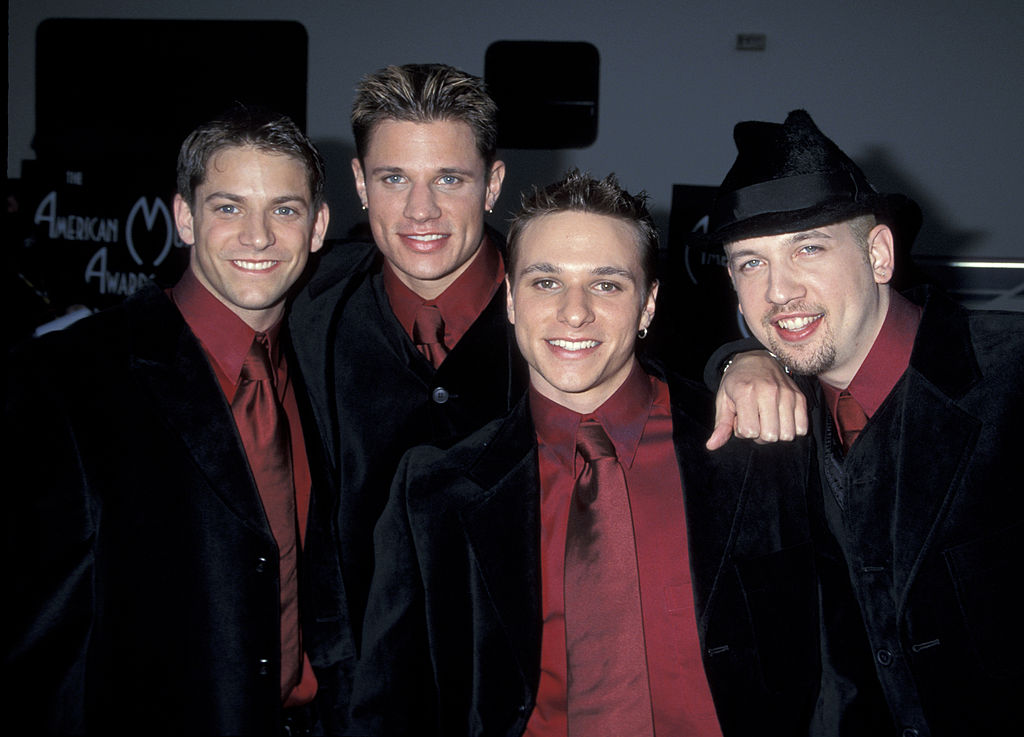 The group 98 degrees poses for a photo.