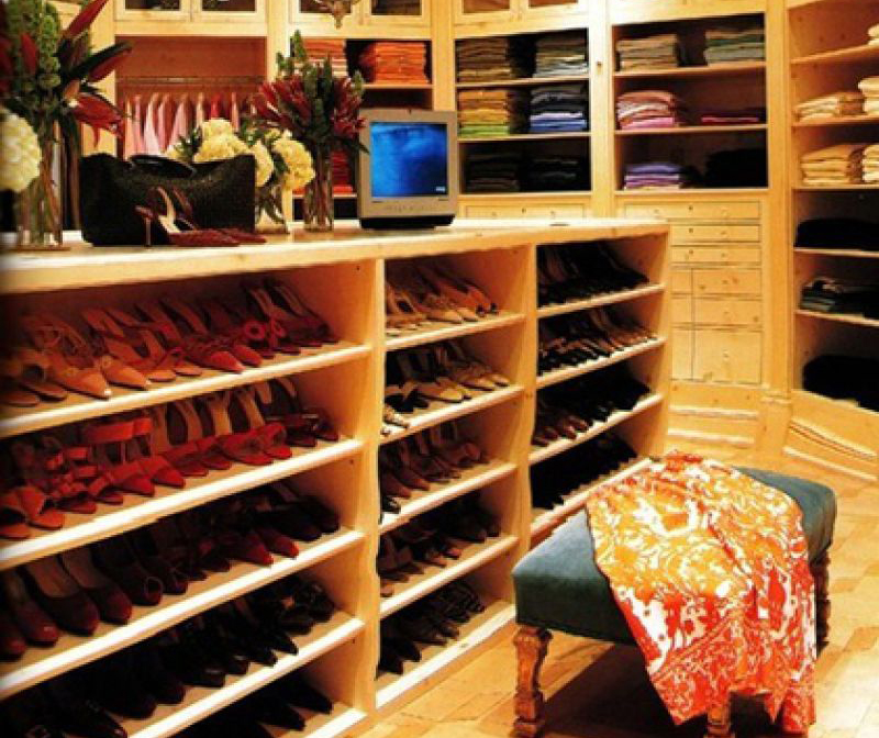 A peek inside Oprah's closet shoes shoes, clothes, and bags neatly stored.