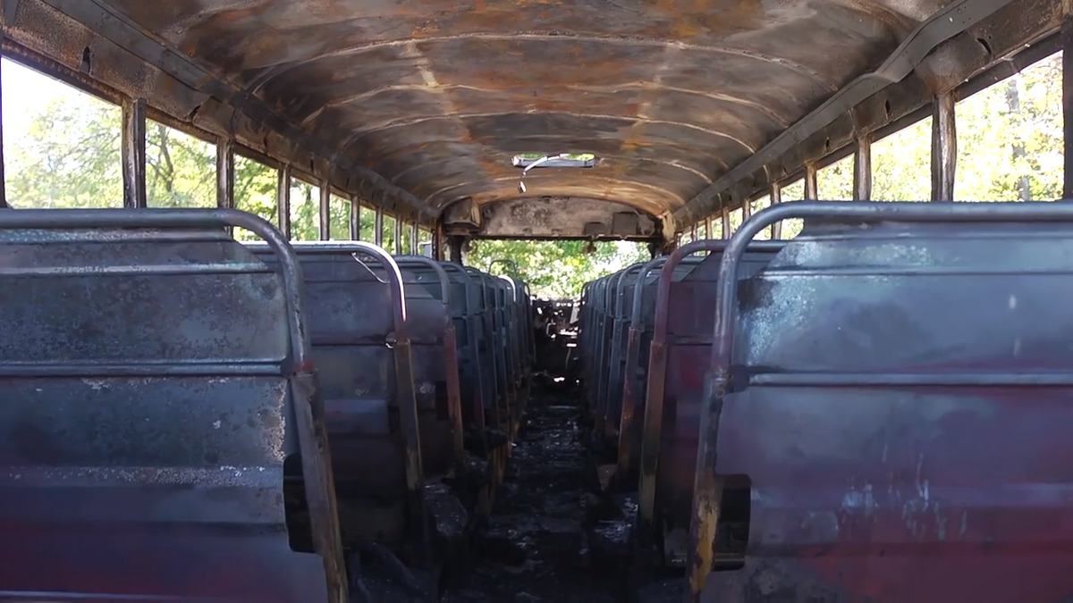 the inside of a burned school bus