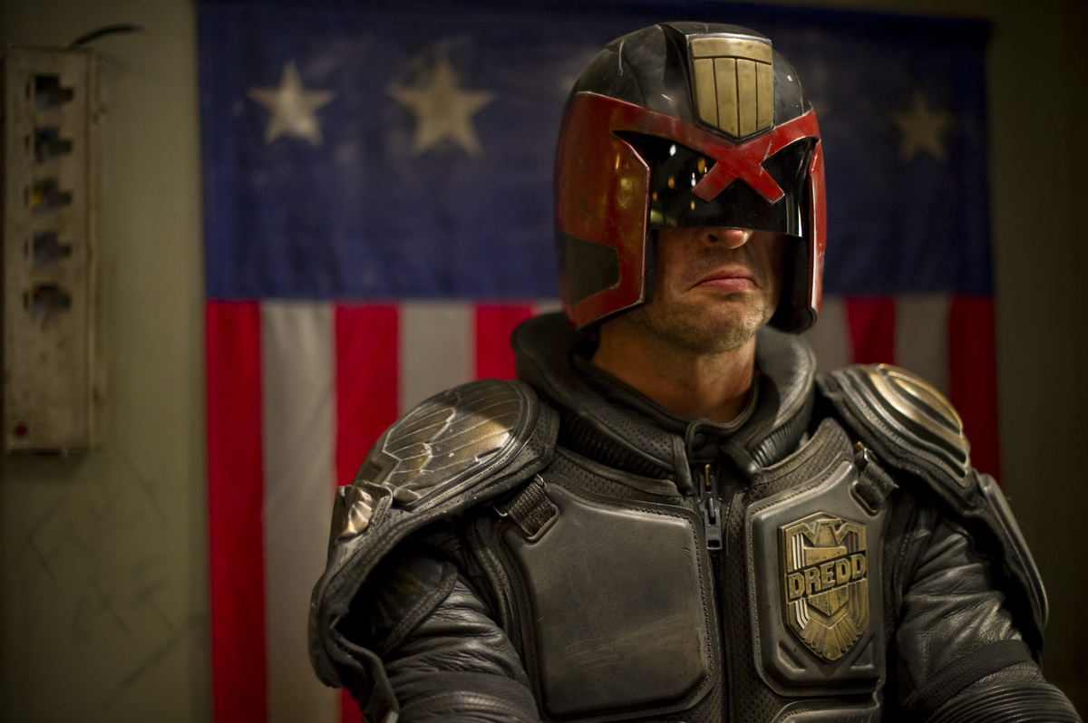 Judge Dredd wears a frown under his mask.