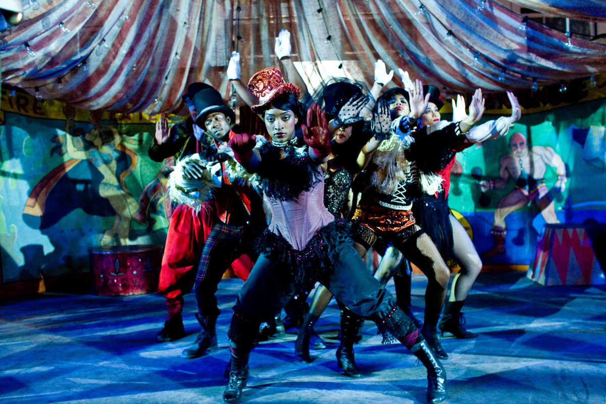 Performers dress in circus attire during a dance number.