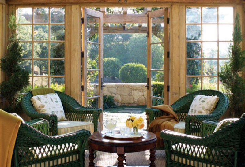 A view inside Oprah's tea house shows chairs, a table, and a stone porch.