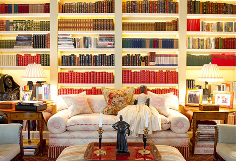 Shelves of books sit behind a couch in Oprah's library.