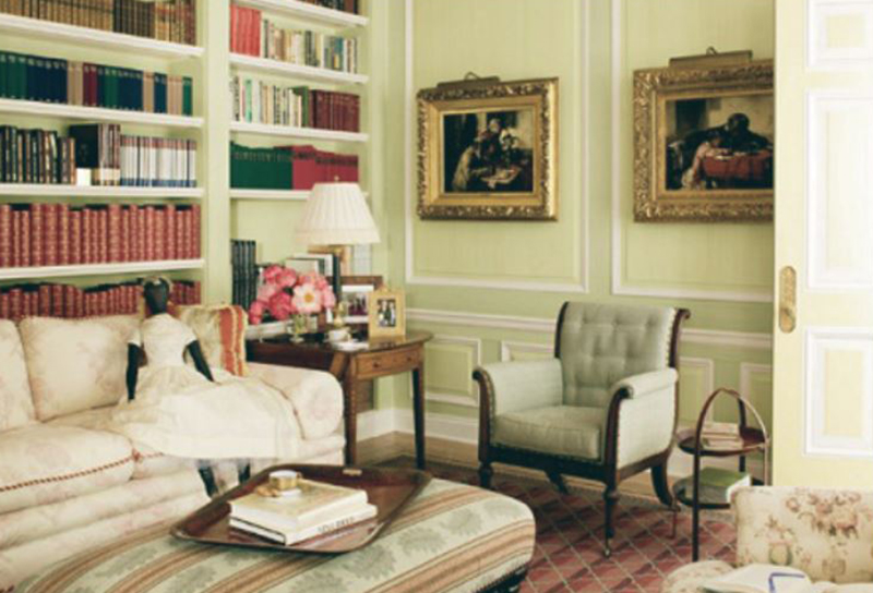 A view of Oprah's reading room features a couch, chair, and shelves full of books.