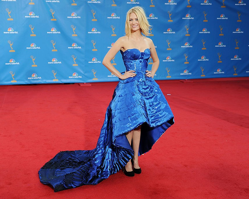January Jones wears a blue strapless, textured, high-to-low gown.