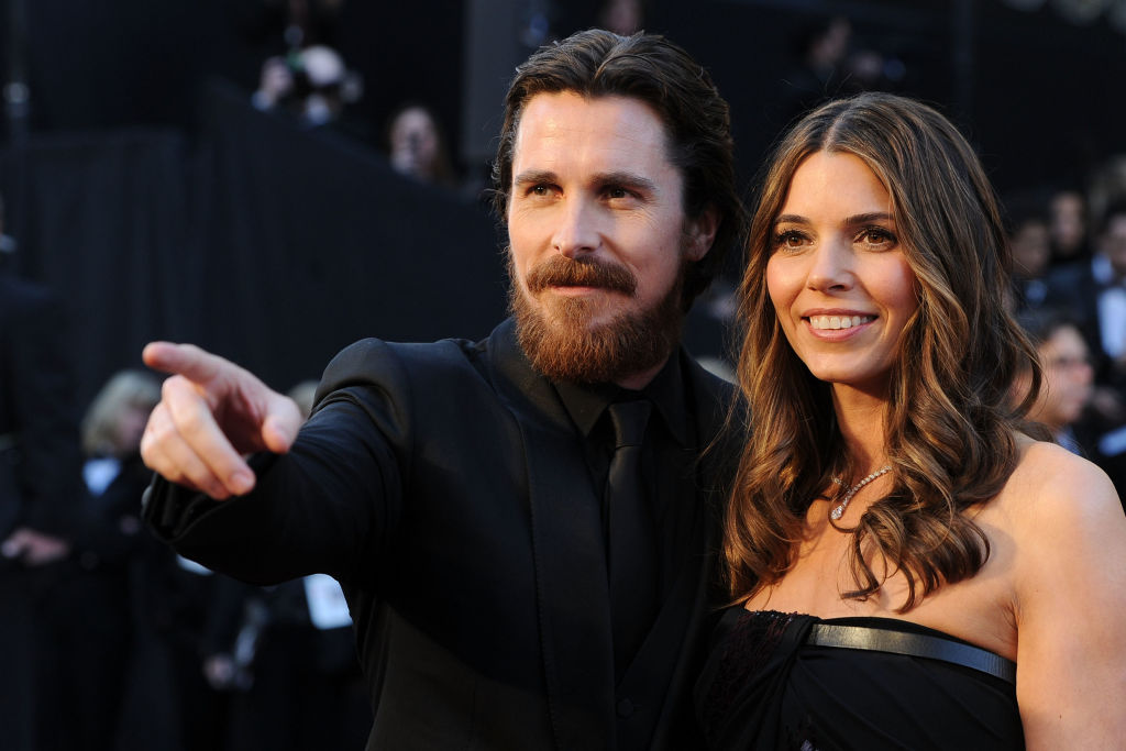 Christian Bale points something out to his wife.