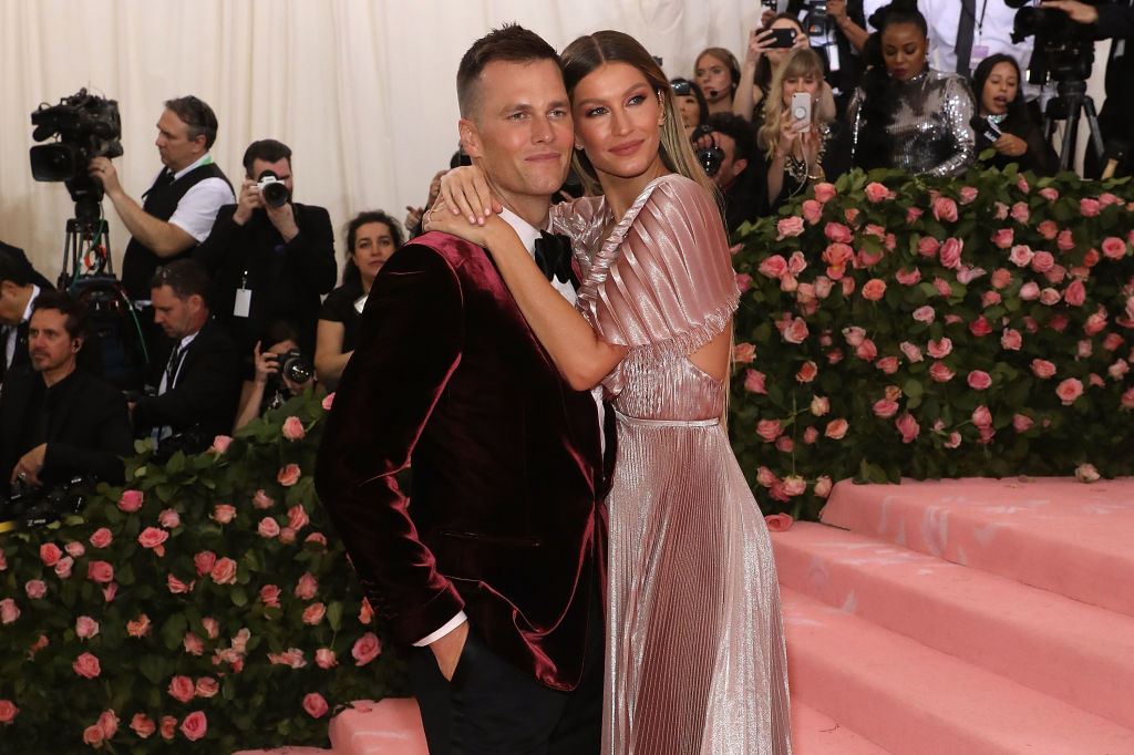 embracing on the pink carpet