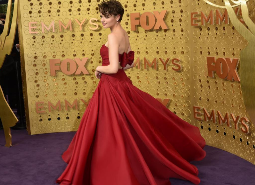 Joey King swirls in her wide-skirted, red gown.