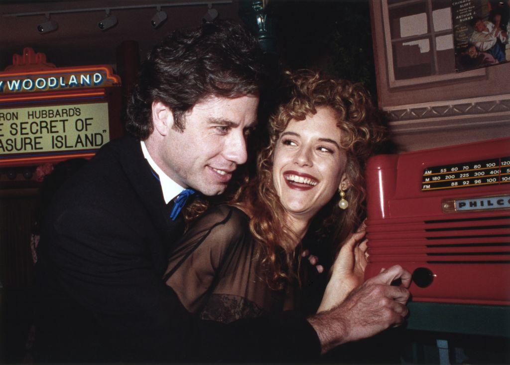 Kelly Preston smiles at John Travolta.
