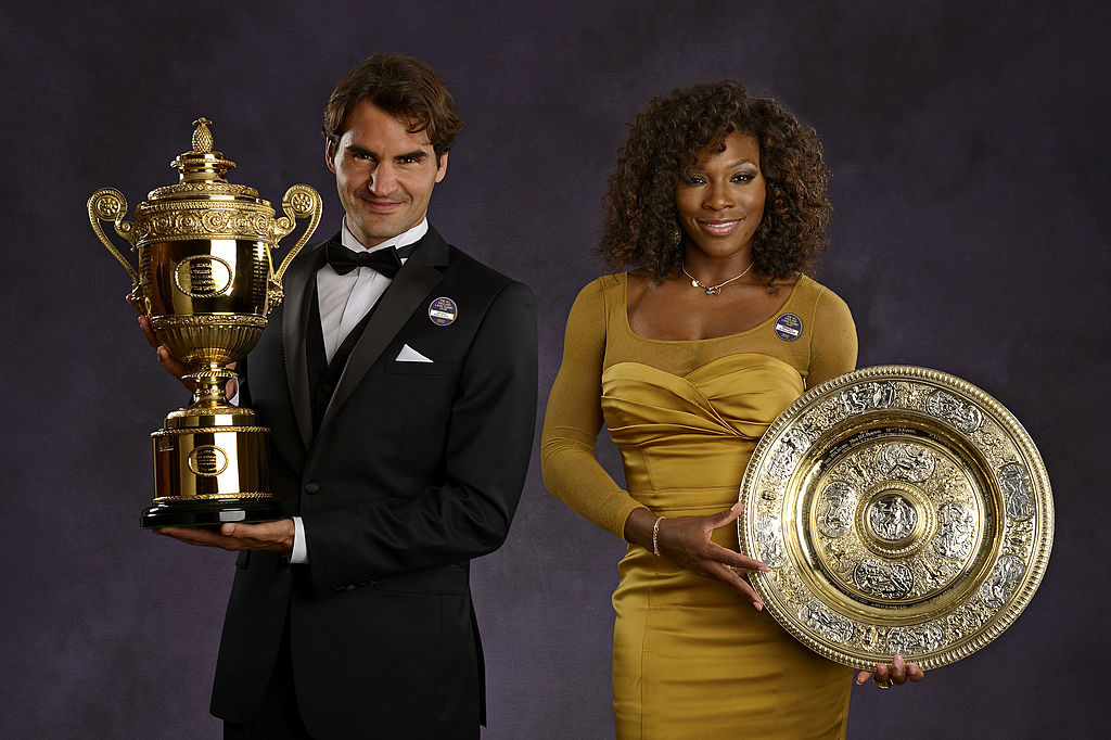Serena Williams and Roger Federer pose with their Wimbledon trophies.