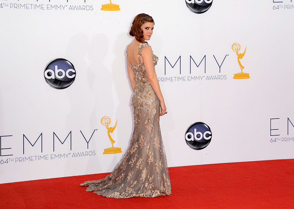 Kate Mara wears a long gown with metallic-gold accents.