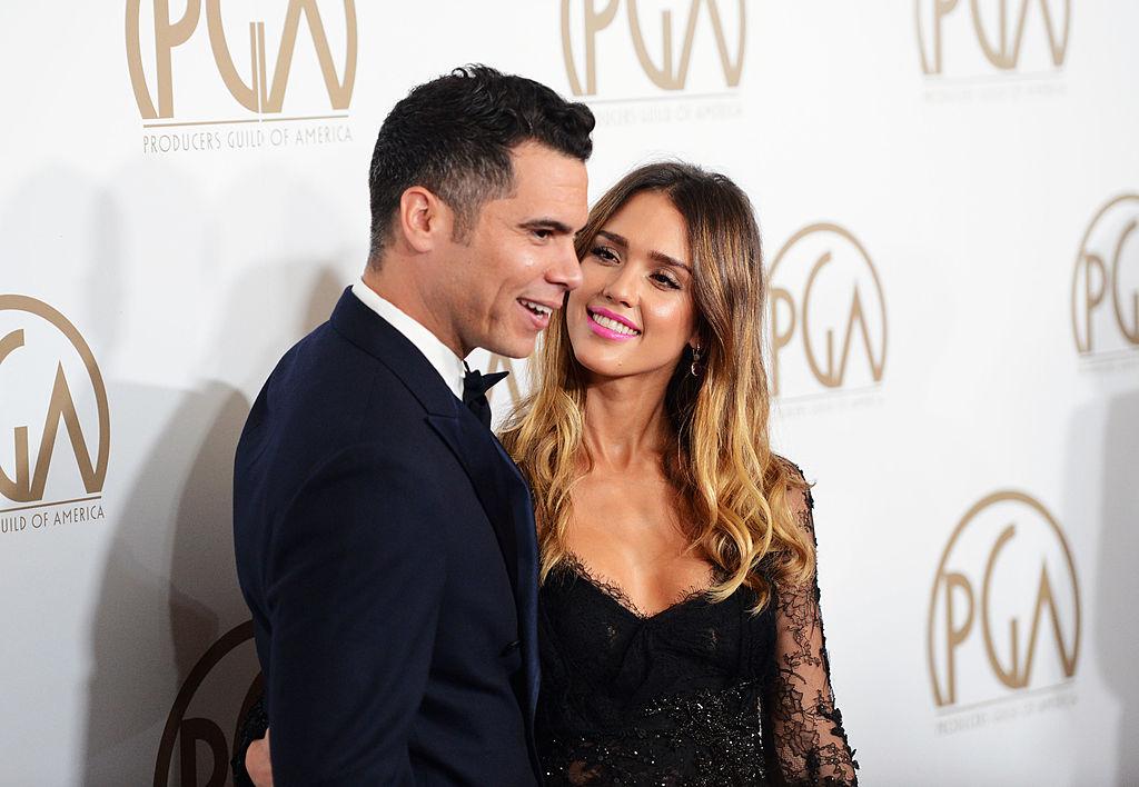Jessica Alba smiles at her husband.