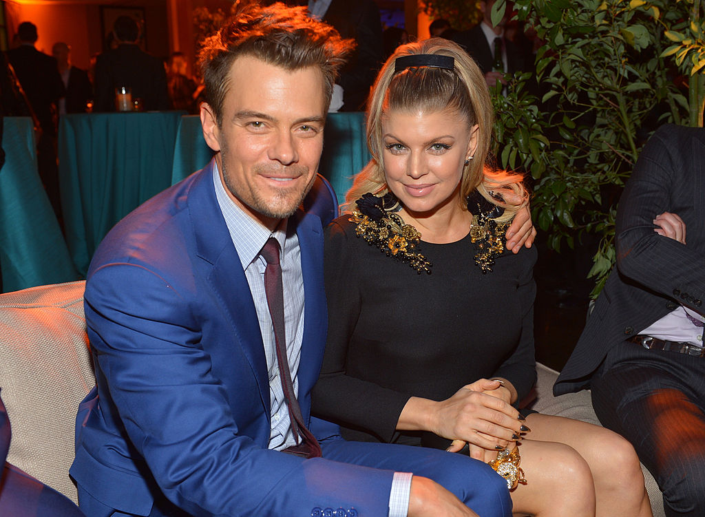 Josh Duhamel and Fergie pose together at a party.