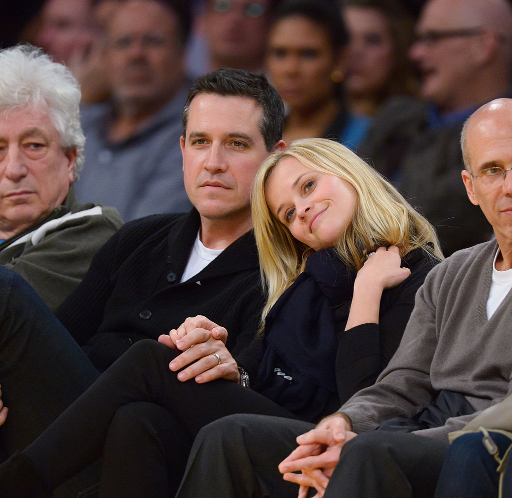 Reese Witherspoon leans her head on her husband's shoulder.