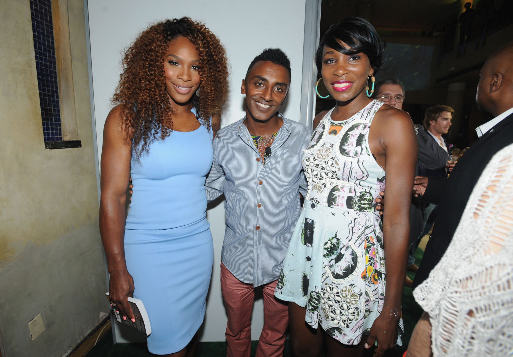 Serena poses with her sister and Chef Marcus Samuelsson at a Taste of Tennis event.