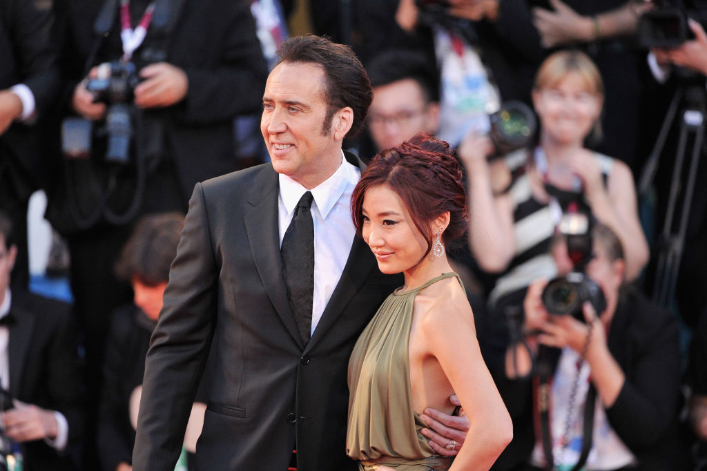 Nicholas and Kim pose on the red carpet.