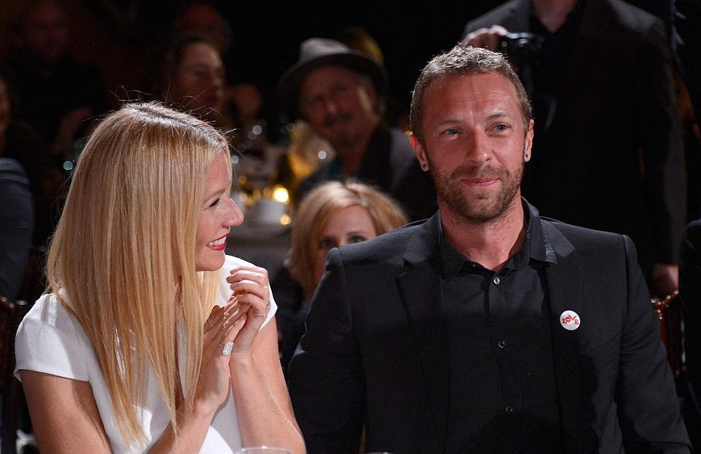 Gwyneth smiles at Chris.