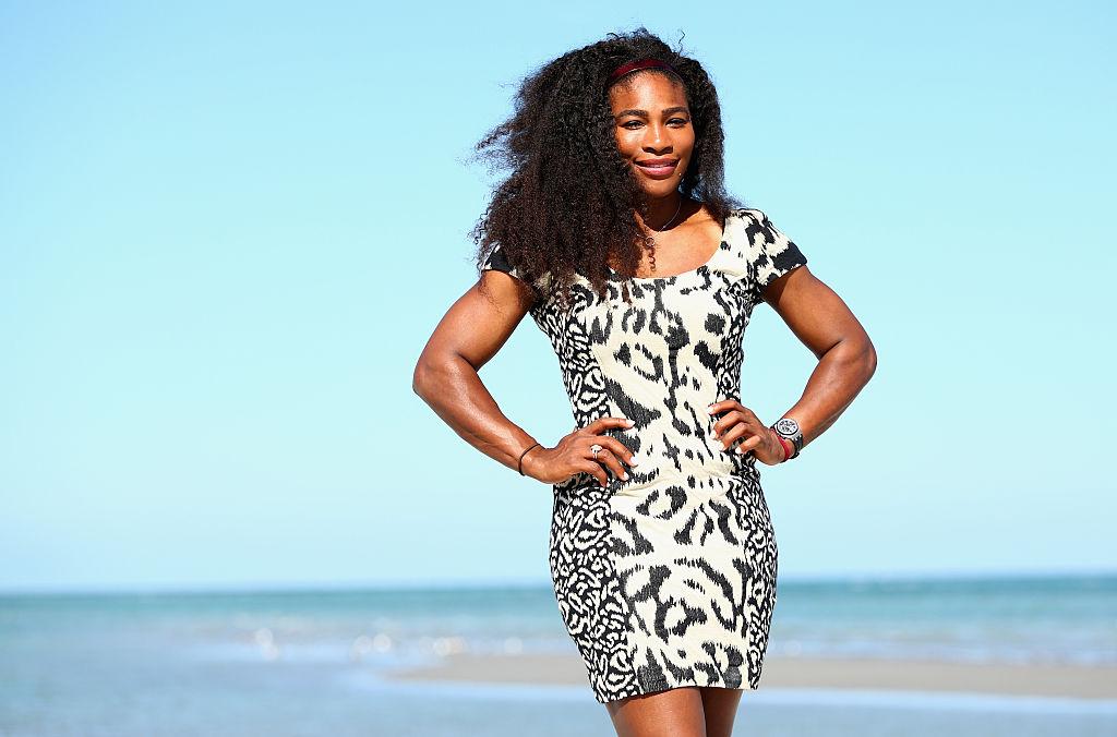 Serena wears a cheetah-print dress on the beach.