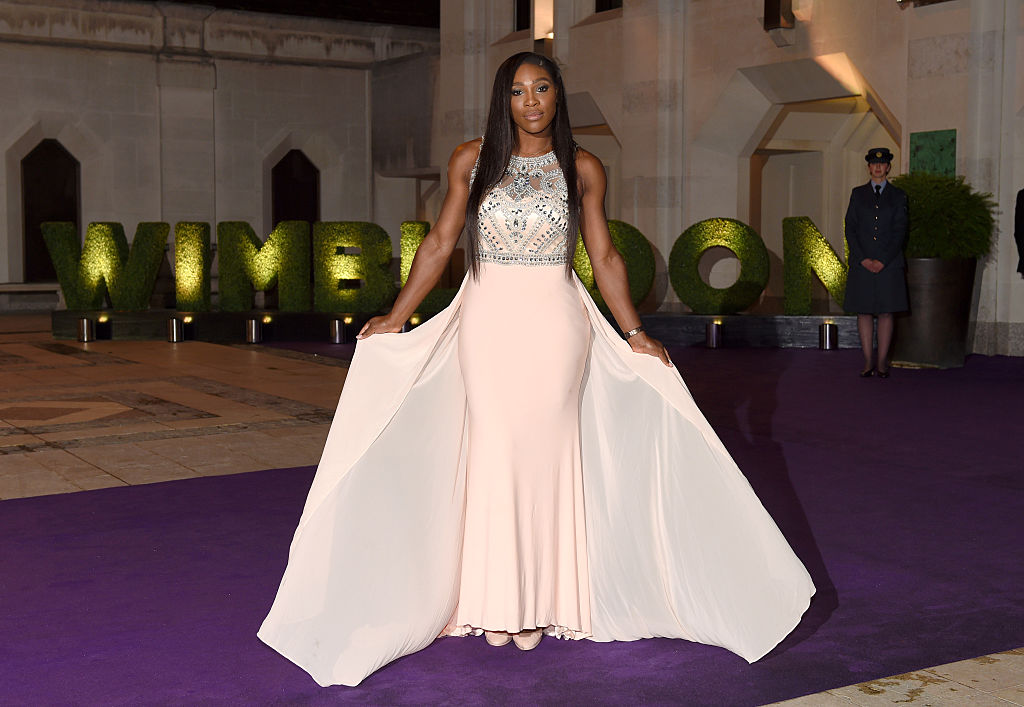 Serena poses in a London courtyard wearing a glamorous gown.