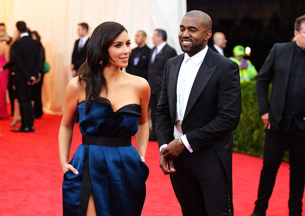 Kanye smiles at Kim.