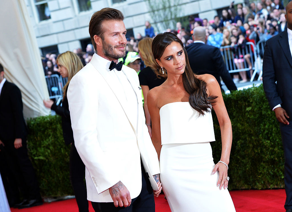 David and Victoria Beckham pose together at an event.