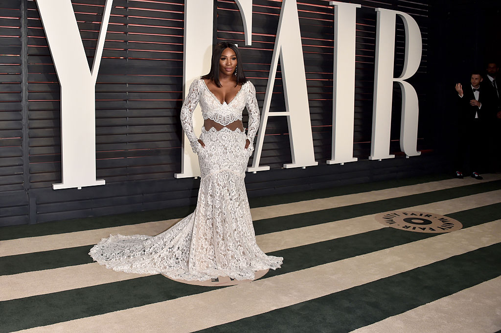 Serena poses in a patterned, white gown.
