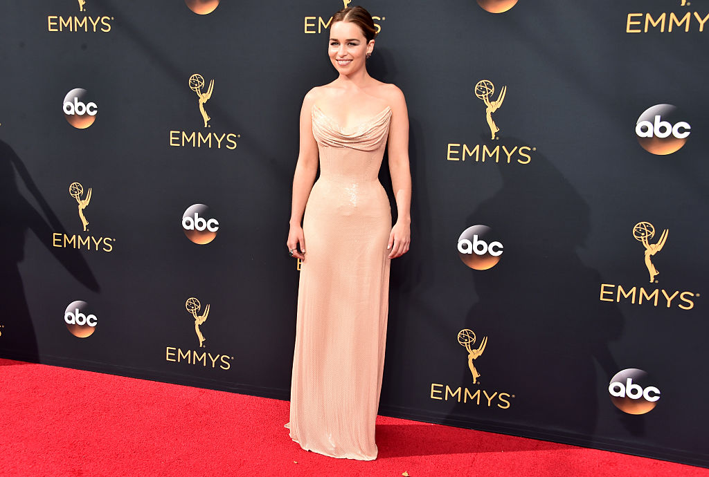 Emilia Clarke wears a slick gown that matches the tone of her skin.