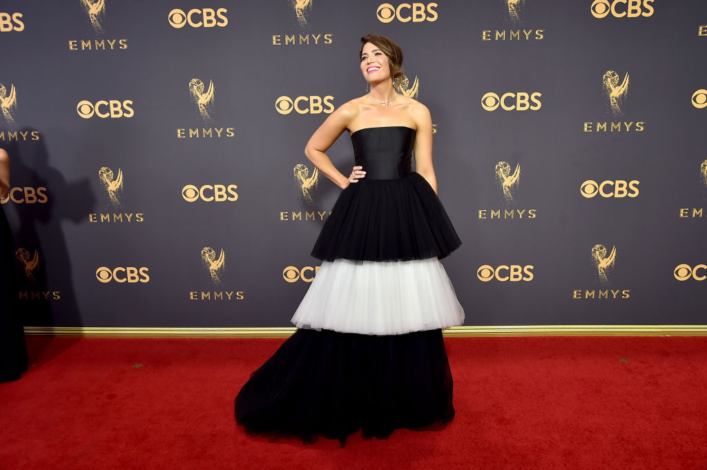 Mandy Moore wears a black and off-white, layered gown.