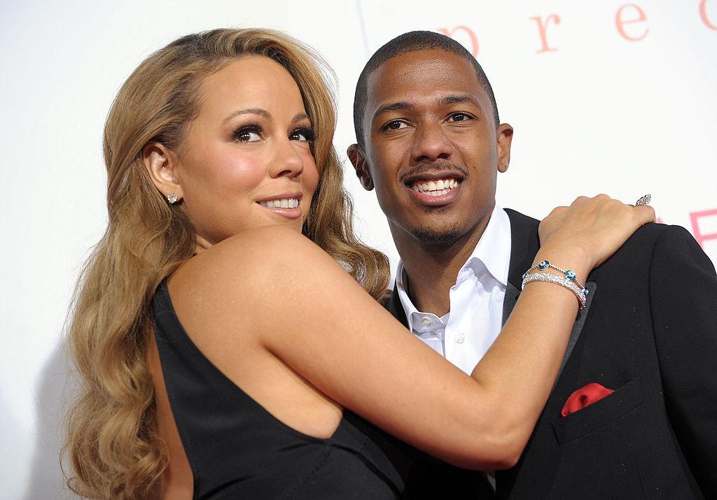 Mariah puts her arm around Nick.
