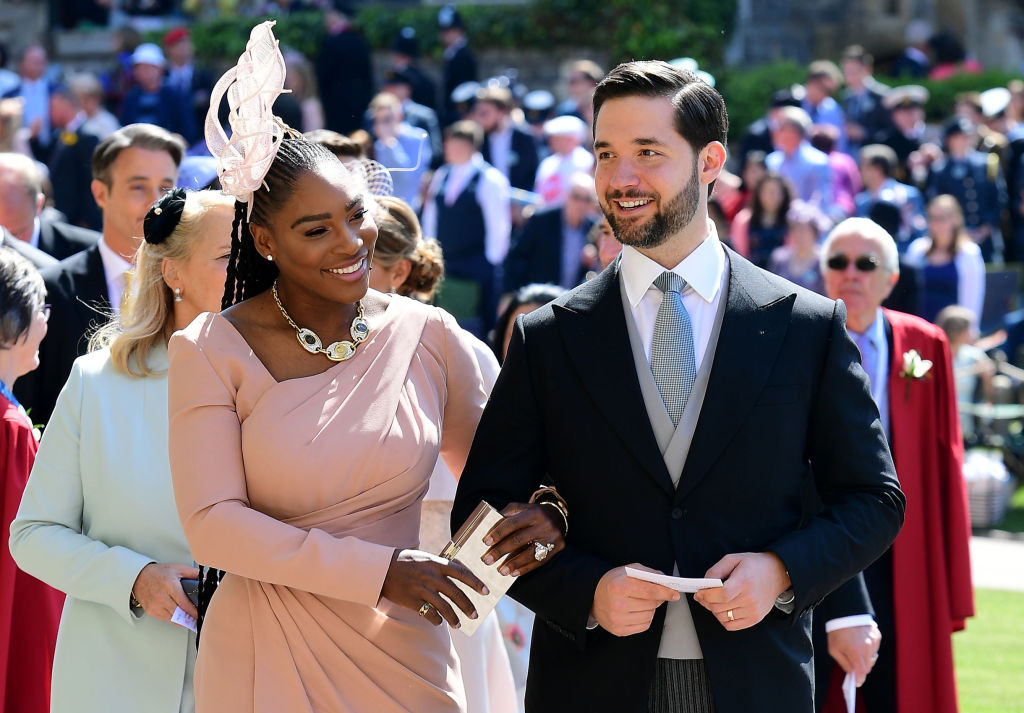 Serena attends the royal wedding wearing a soft pink ensemble and linking arms with her husband.