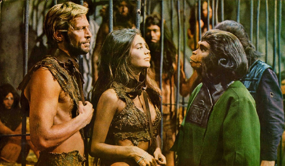 two human actors with one of the apes in beneath the planet of the apes